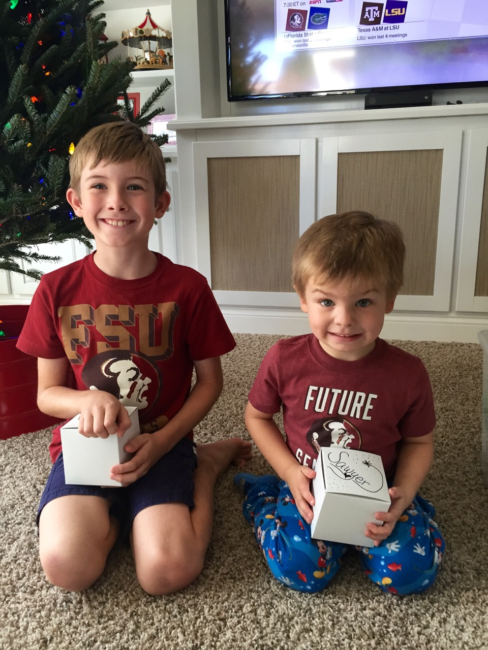Boys Opening Christmas Ornament