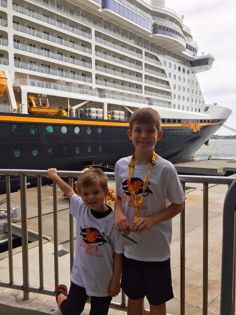 Posing at the DIsney Cruise Line Port in front of the DIsney Dream