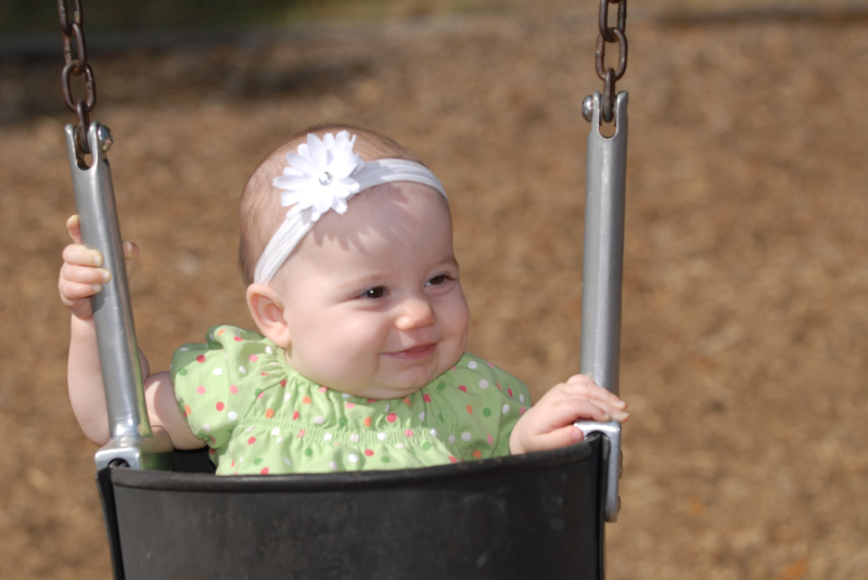 Lily swinging for the first time