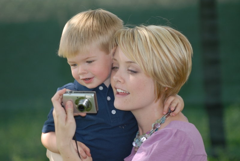 Mom and Hunter looking at pictures