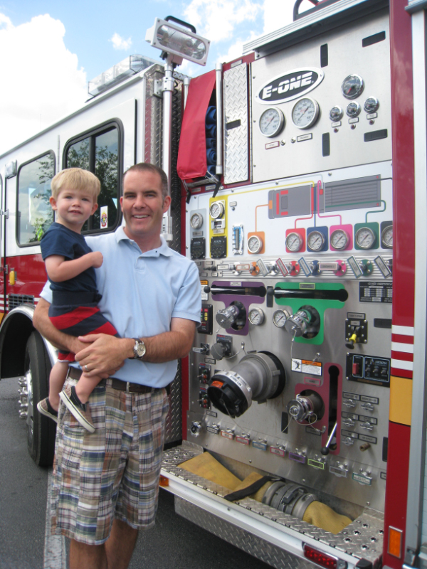 Hunter & Patrick in front of firetruck