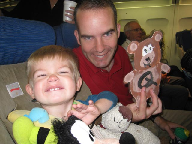 Patrick & Hunter on airplane.
