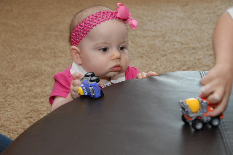 Lily playing with trucks