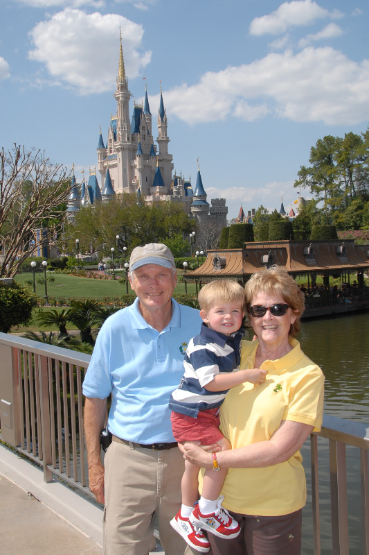 Grandma, Poppop and Hunter in front of castle