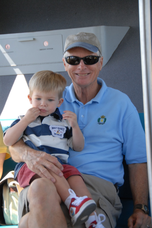 Poppop and Hunter riding monorail