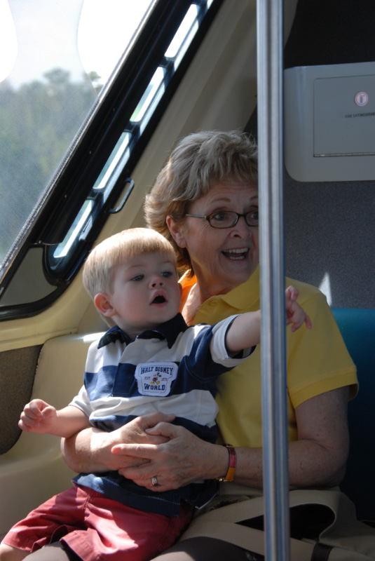 Grandma and Hunter riding monorail