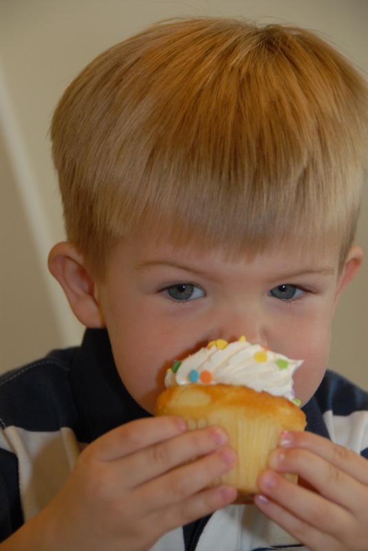 Hunter digs into his birthday cupcake