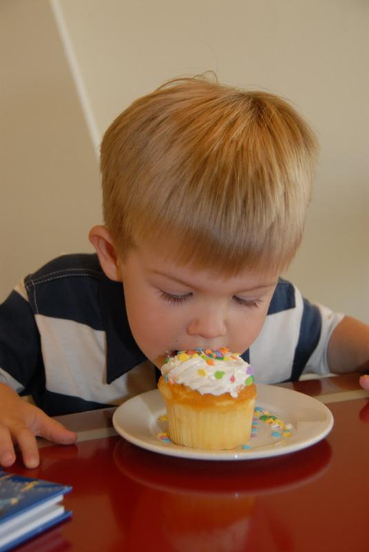 Hunter digs into his birthday cupcake